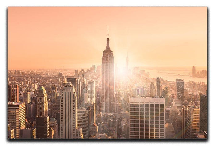 Manhattan downtown skyline with illuminated Empire State Building Canvas Print or Poster