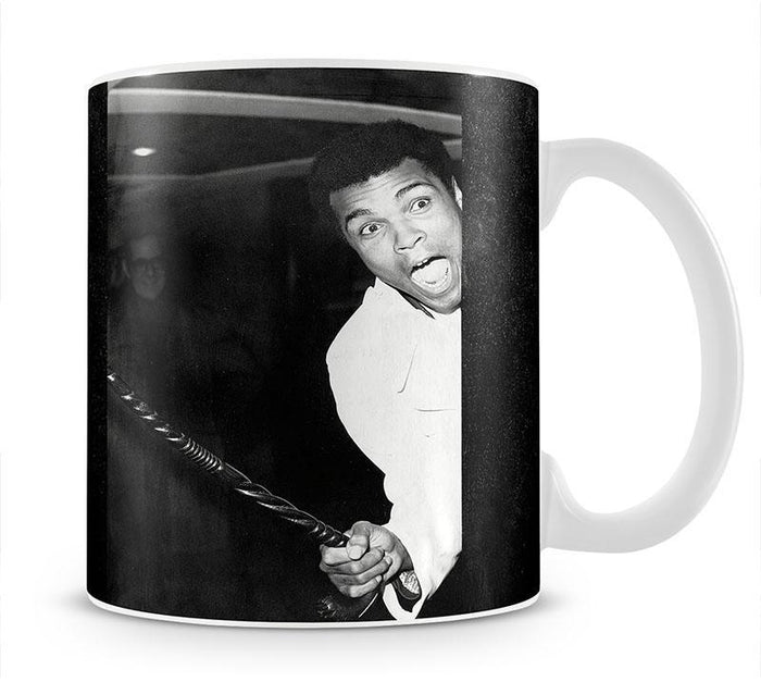 Muhammad Ali larking about at Heathrow Mug