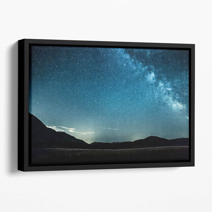 Night sky with stars milky way over mountains Floating Framed Canvas