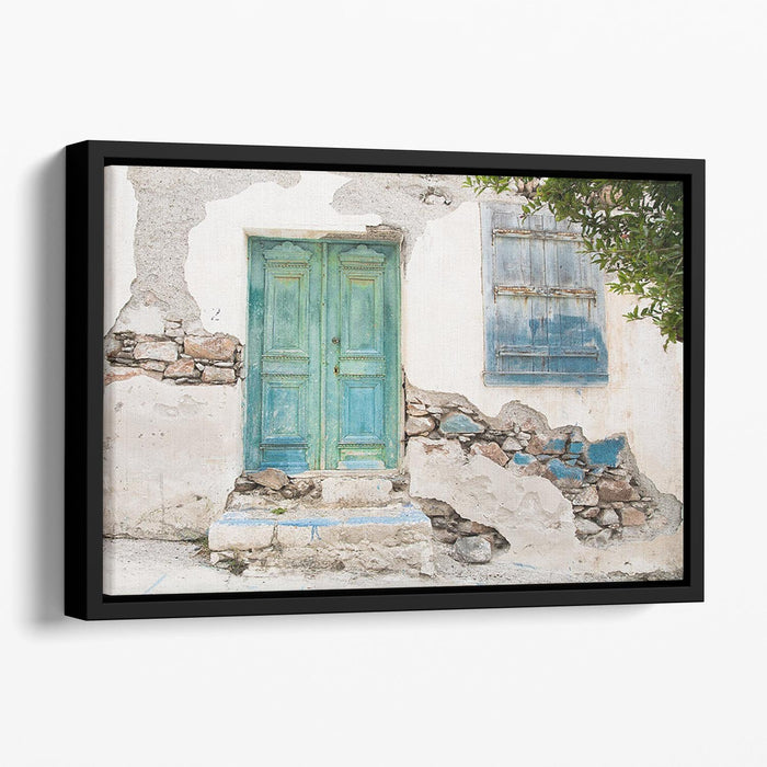 Old wooden door of a shabby demaged house Floating Framed Canvas