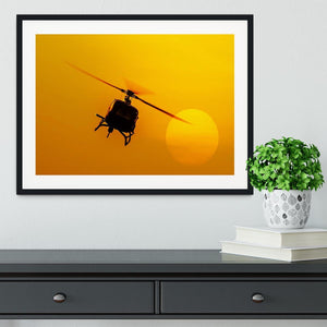 Patrol helicopter flying in sunset Framed Print - Canvas Art Rocks - 1
