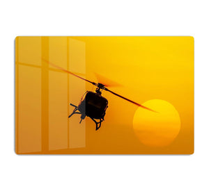 Patrol helicopter flying in sunset HD Metal Print