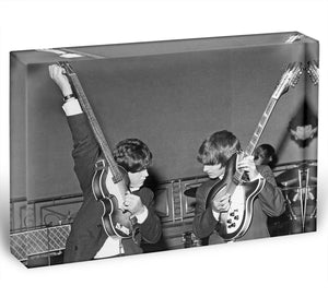 Paul McCartney and George Harrison tune their guitars Acrylic Block - Canvas Art Rocks - 1