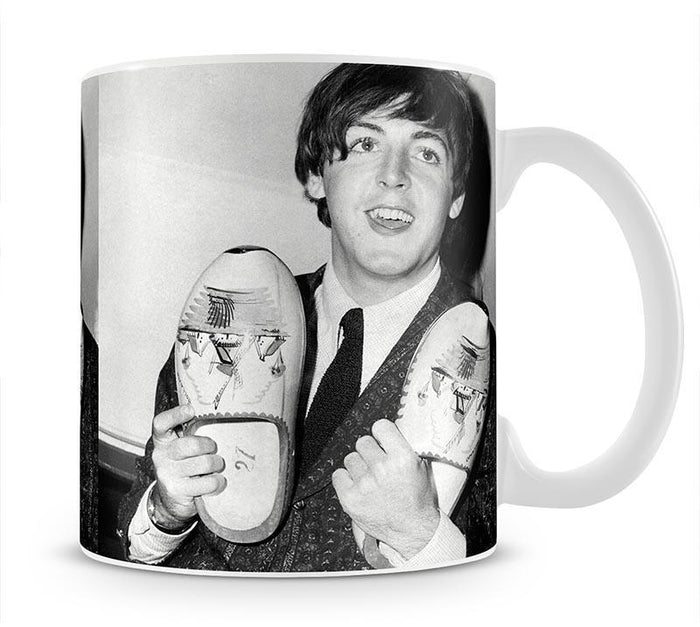 Paul McCartney with a pair of clogs Mug