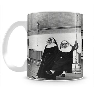 Peter Cook and Dudley Moore dressed as nuns Mug - Canvas Art Rocks - 2