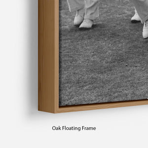 Prince Philip leading his cricket team onto the field Floating Frame Canvas