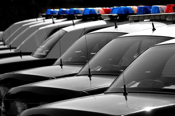 Row of Police Cars with Blue and Red Lights Wall Mural Wallpaper