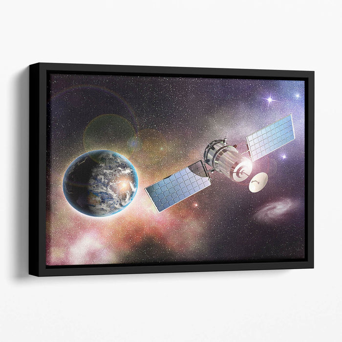 Satellite orbiting the earth in the outer space Floating Framed Canvas