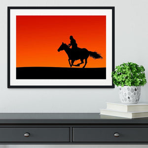 Silhouette of a horse and rider at sunset Framed Print - Canvas Art Rocks - 1
