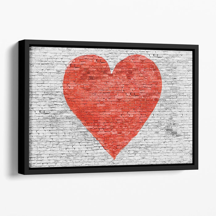 Symbol of love painted on white brick Floating Framed Canvas