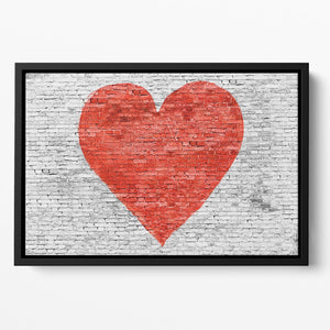 Symbol of love painted on white brick Floating Framed Canvas - Canvas Art Rocks - 2