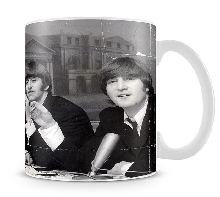 The Beatles at a press conference with their MBEs Mug