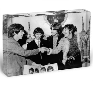 The Beatles shaking hands in 1967 Acrylic Block - Canvas Art Rocks - 1
