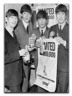 The Beatles with an Oxfam poster Canvas Print or Poster  - Canvas Art Rocks - 1