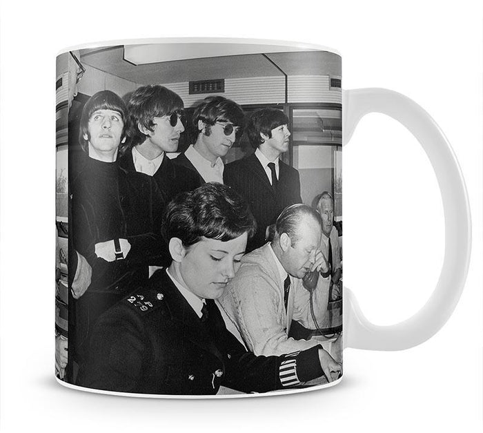 The Beatles with police at London Airport Mug