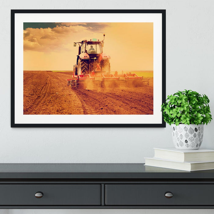 Tractor in sunset Framed Print