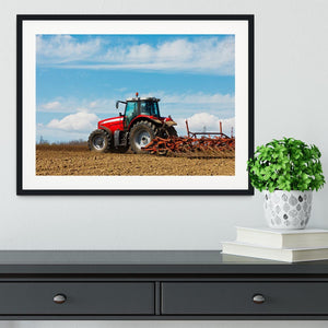 Tractor plowing the field Framed Print - Canvas Art Rocks - 1