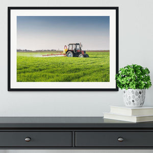 Tractor spraying wheat field Framed Print - Canvas Art Rocks - 1