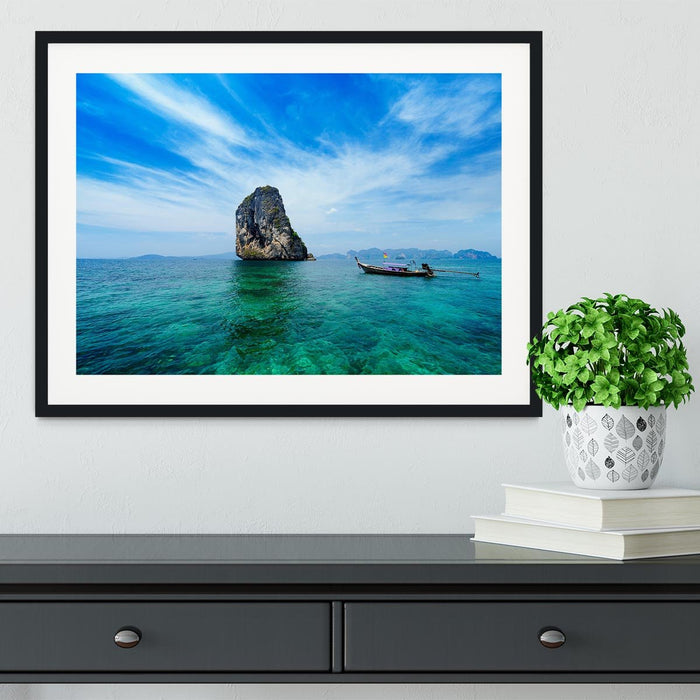 Traditional Thai boat in the blue sea Framed Print