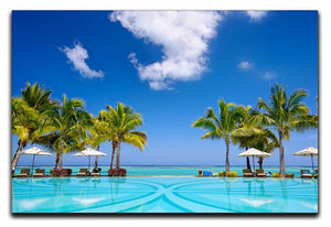 Tropical beach resort with lounge chairs Canvas Print or Poster - Canvas Art Rocks - 1