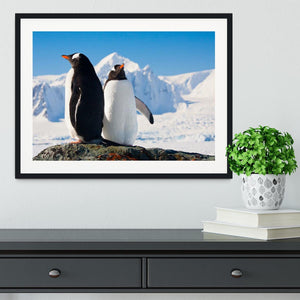 Two penguins dreaming together sitting on a rock Framed Print - Canvas Art Rocks - 1