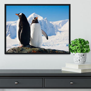 Two penguins dreaming together sitting on a rock Framed Print - Canvas Art Rocks - 2