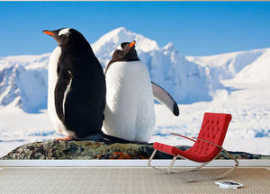 Two penguins dreaming together sitting on a rock Wall Mural Wallpaper - Canvas Art Rocks - 2