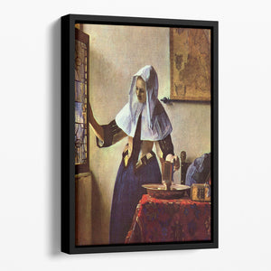 Young woman with a water jug at the window by Vermeer Floating Framed Canvas