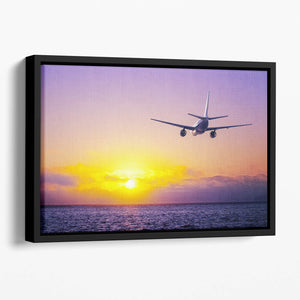 airplane in the sky over ocean Floating Framed Canvas