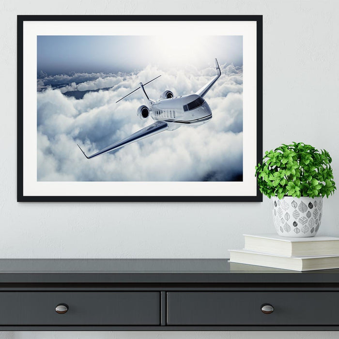 private jet flying over the earth Framed Print