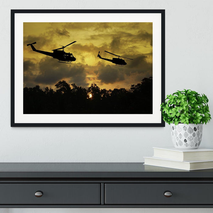two helicopters flying over South Vietnam Framed Print