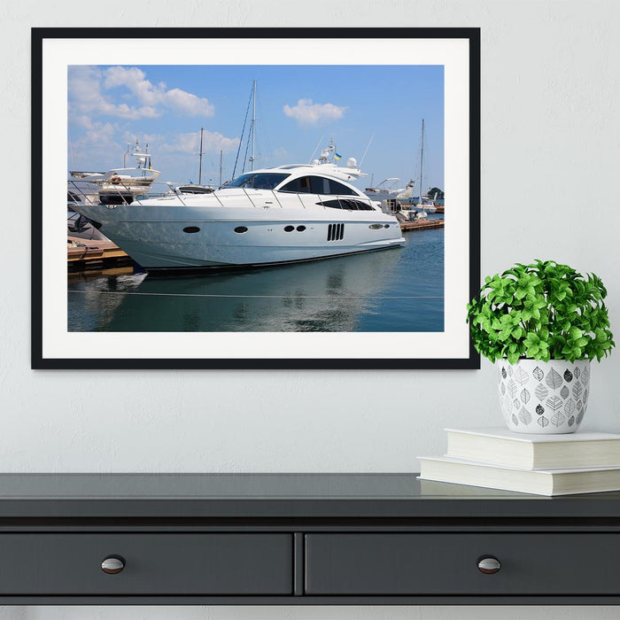 white yacht in marina Framed Print