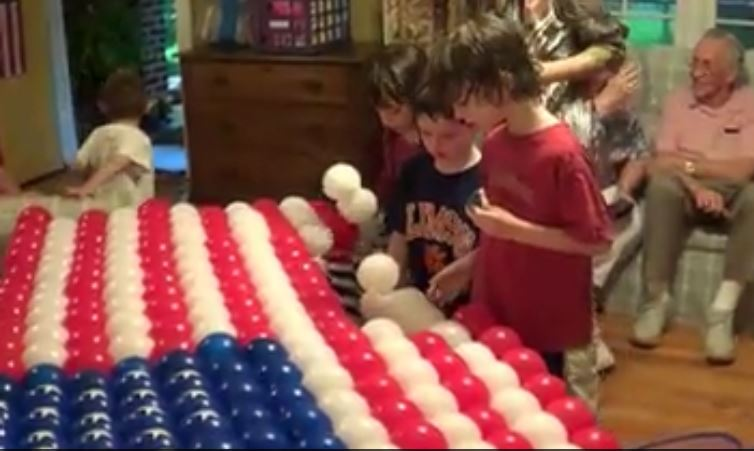 Even the young children helped to make this American flag with Rouse double-bubble balloons and Rouse Matrix Flag Kit balloon grid frame.