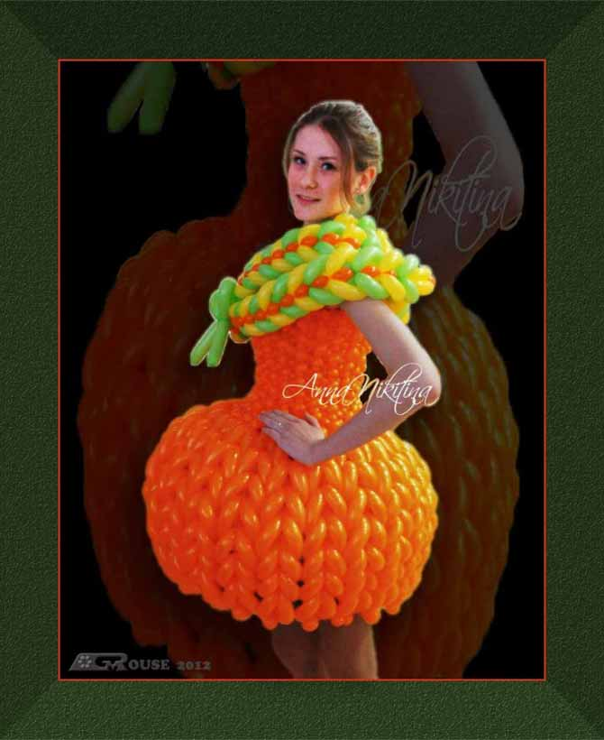 Photo of woman in orange dress MadeWithBalloons