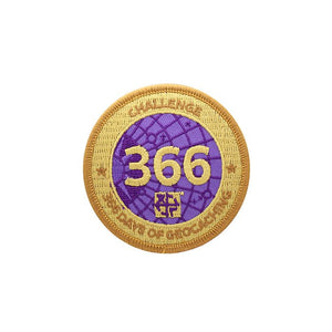 Patch with a gold background and a purple centre.  Over the purple it says 366.  Around the edge it says Challenge 366 Days of Geocaching.