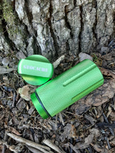 Close up of green geocache with the lid off