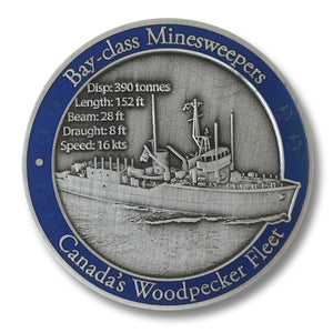 Front of coin in antique silver showing large 3D image of ship, with technical details and a blue translucent paint border.