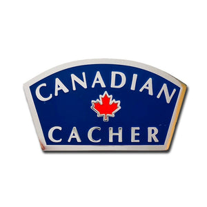 Canadian Cacher pin with a blue background and silver writing with a red maple leaf in the centre