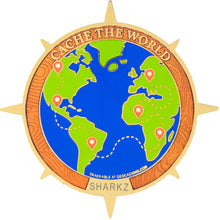 Front image showing polished gold trackable geocaching coin features a full colour globe with extended compass rose points and detailed topography art.
