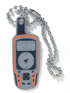 Front of trackable tag. Shaped like a Garmin Map62 GPS. Front shows To Adventure: 42km. Arrow points to NE. A ball chain is attached.