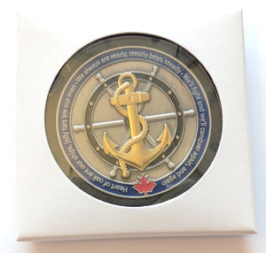 Navy coin displayed in an acrylic case with the paper box surrounding it