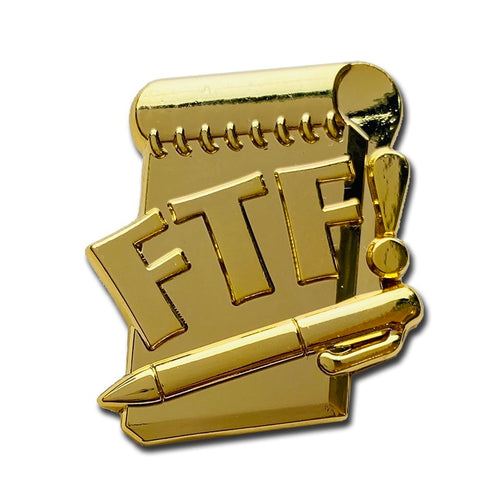 All gold FTF pin with a log book and pen that says FTF on top