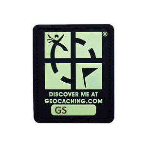 Black and glow in the dark green geocaching patch with trackable code