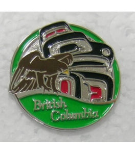 Pin with a brown eagle in front of Haida art, with a green background and British Columbia written at the bottom