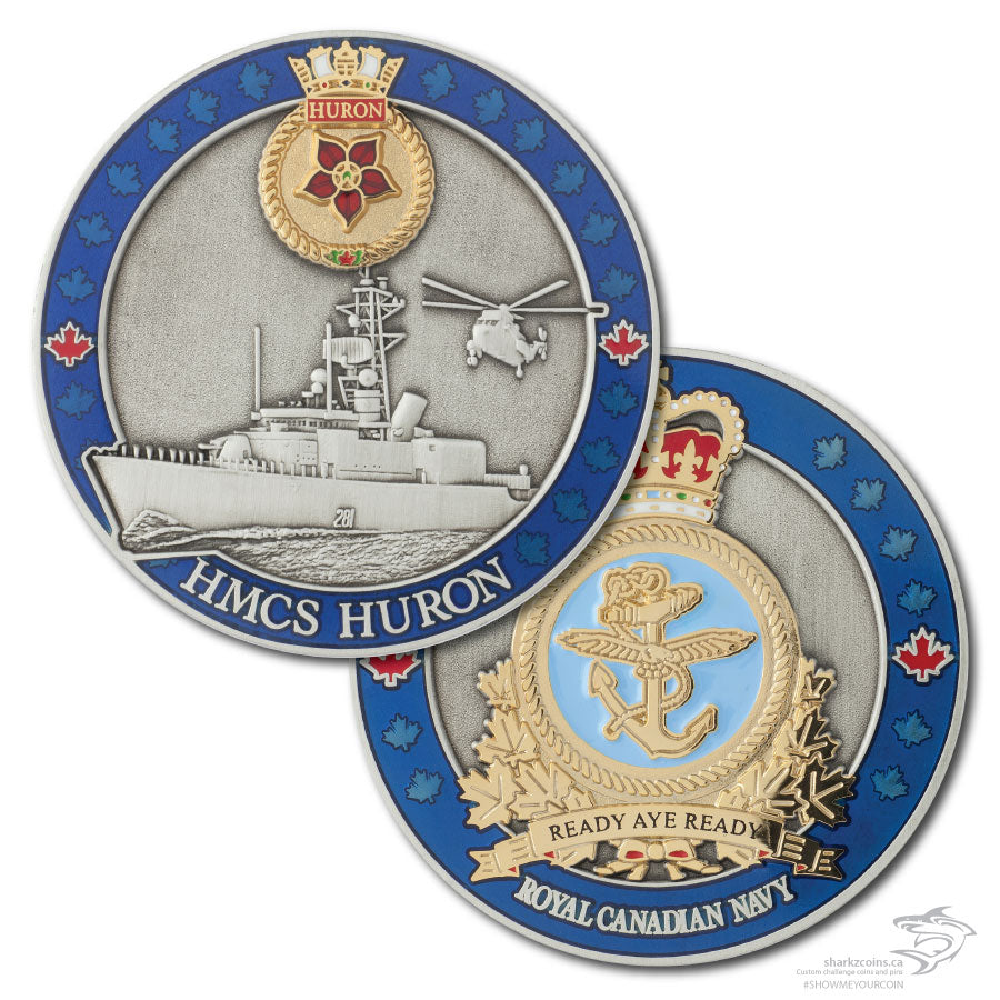 Back and front of HMCS Huron coin.  Antique silver and polished gold on both sides, with a 3D image of the boat and a helicopter on the front and the boat's crest on the back in polished gold