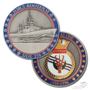 Both sides of the HMCS Kootenay coin are pictured.  The front has a 3D antique silver image of the with a red and blue border, the back is a 2 tone polished gold and antique silver with the ship's crest and the red and blue border.
