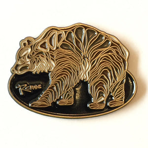 Bear shaped pin with done by Canadian artist Robbie Craig.