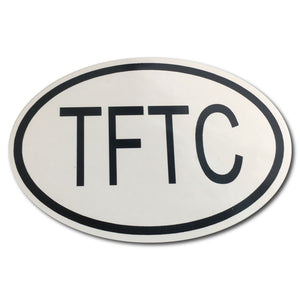 "Oval bumper sticker that says ""TFTC' In black on a white background"