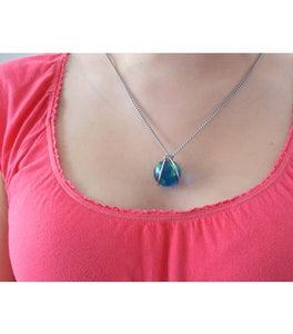 Track Your World Marble in necklace being worn