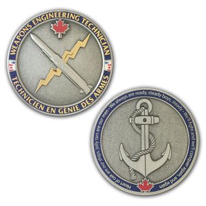antique silver coin with shiny gold accents with the weapons engineering trade badge on one side and a fouled anchor on the other side.